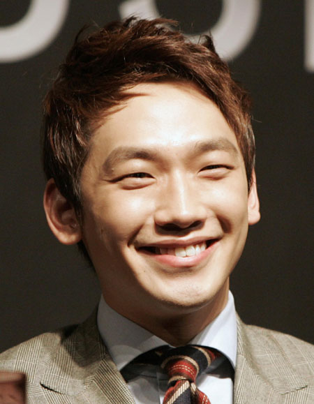 South Korean star Rain smiles during news conference for his new movie 'Ninja Assassin'