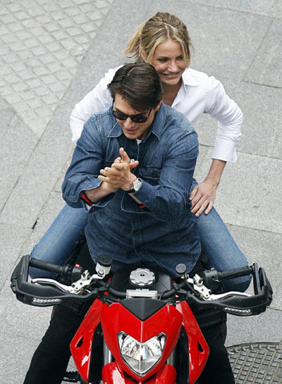Cruise and Diaz ride motorbike during the filming of