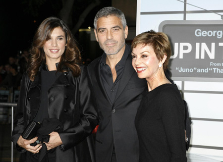 George Clooney and his girlfriend pose at the premiere of