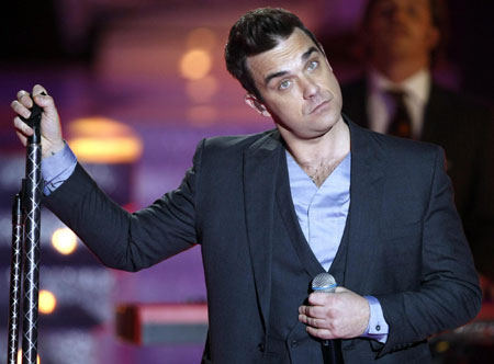 Robbie Williams performs during the Miss France 2010 pageant in Nice