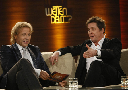 Hugh Grant attends game show
