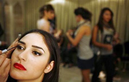 Miss Arab beauty pageant. An Israeli-Arab contestant has make-up applied