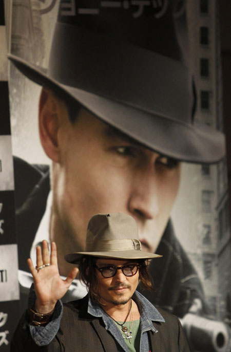 Johnny Depp attends a news conference to promote his movie