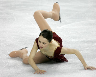 Sasha Cohen Of The US Falls As She Performs Her Free Skate At World Figure Skating Championships In Calgary March 25 2006 Reuters