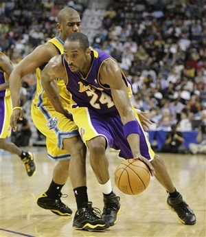 Los Angeles Lakers guard Kobe Bryant drives past New Orleans Hornets guard Chris  Paul in the second half of an NBA basketball game in New Orleans on Friday ec1e7fa3e