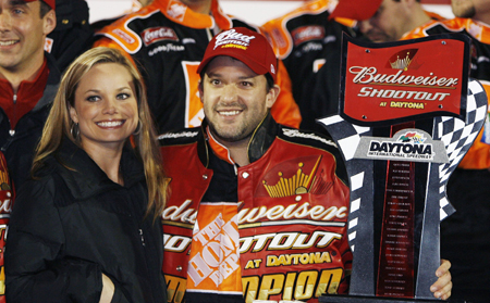 NASCAR Nextel Cup Series driver Tony Stewart (R) celebrates his win in