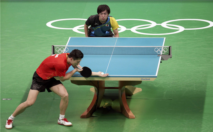 Chinese men's table tennis overcomes singles loss to win ...
