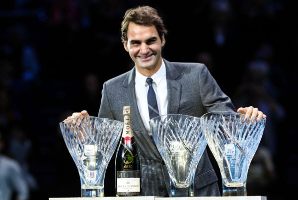 Roger Federer with his three ATP Awards