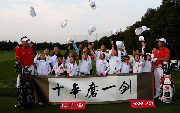 Poulter and Wenchong celebrate HSBC Champions 10th anniversary with