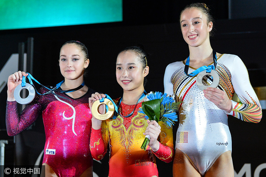 China's Fan defends uneven bars title at gymnastics worlds