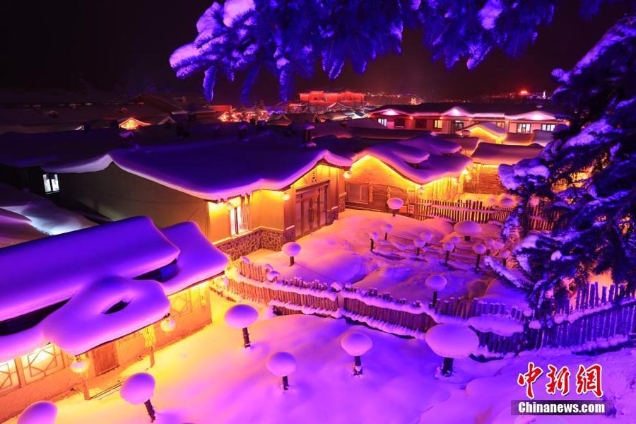 A nighttime winter wonderland in China's snow town