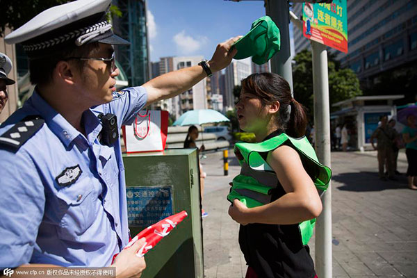 Green hats as punishment for traffic violations[1