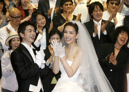 chung celebrate during their marriage ceremony at a wedding hall in