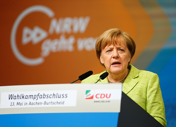 Exit polls show Merkel's CDU wins key German state election