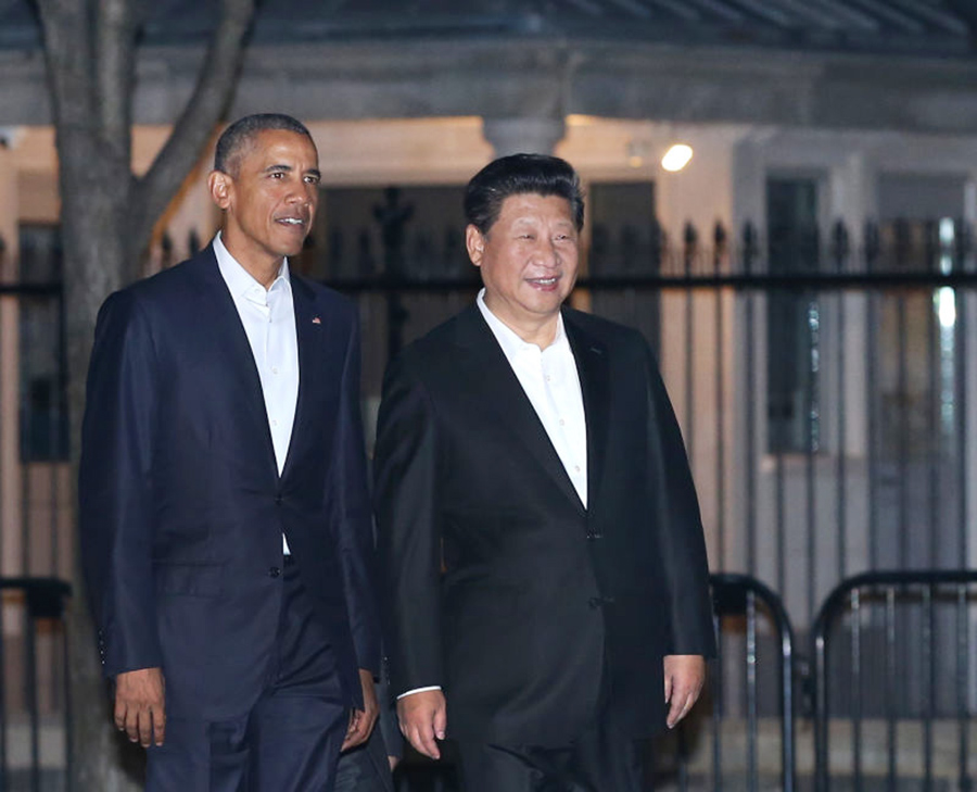 President Xi welcomed by Obama as he arrives in Washington