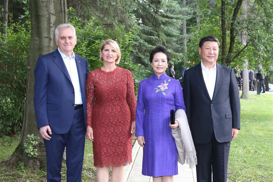 Chinese President Xi Jinping 1st R And His Wife Peng Liyuan 2nd Pose For A Group Photo With Serbian Tomislav Nikolic L