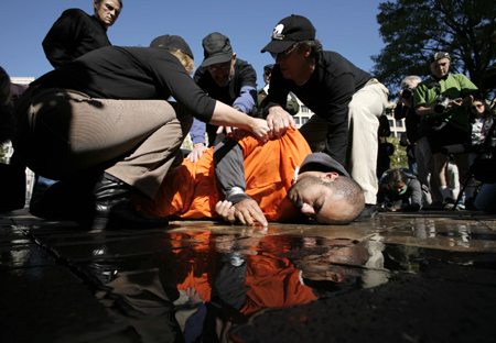 Protesters take turns waterboarding each other