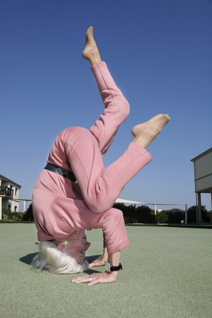 83-year-old Yoga instructor, Bette Calman, performs Yoga moves in