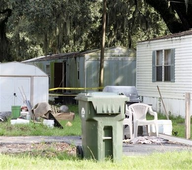 7 Found Slain At US Mobile Home 2 Badly Hurt