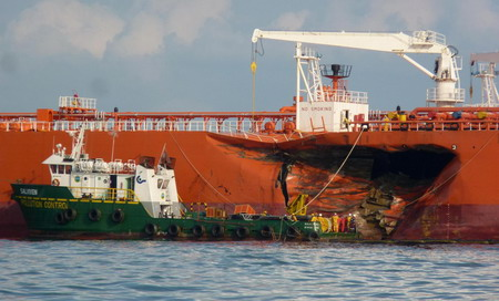 Oil spills off Singapore after tanker collision