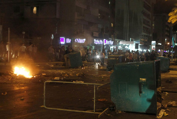 Lebanese Sunni Muslim residents burn tires and block a road at Corniche al-Mazraa in Beirut's main highway to protest the killing of Sheikh Ahmed Abdul Wahid, a Sunni Muslim cleric, and Muhammed Hussein Miraib, both members of the Lebanon-based March 14 political alliance May 20, 2012.