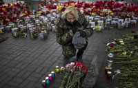 Troop carriers enter east Ukraine town bearing Russian flag