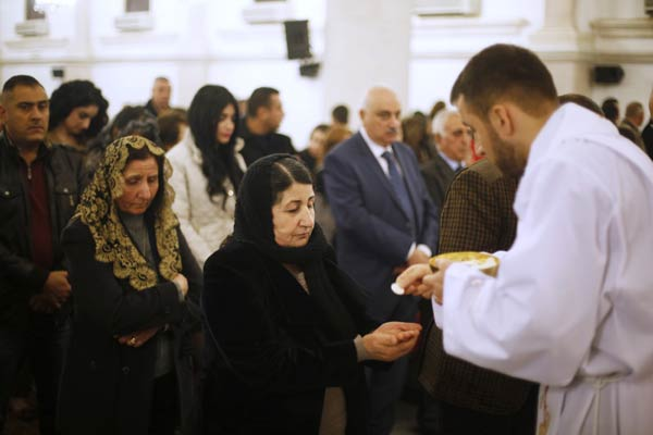 Baghdad's Christians gather defiantly for Christmas Eve mass