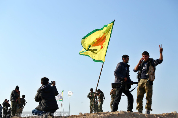 Islamic State group nearly pushed out of Syria's Kobani