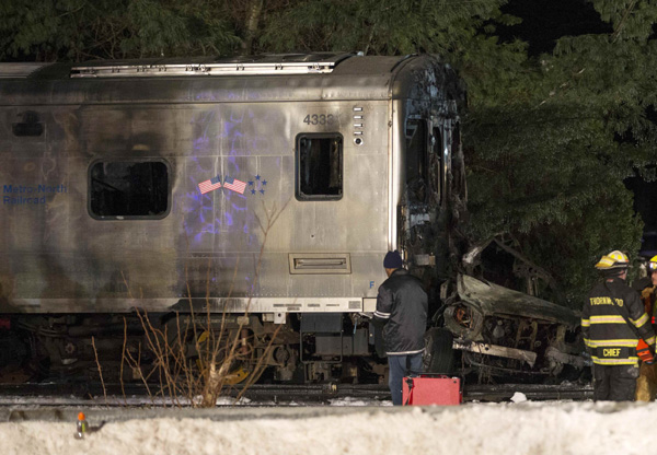 At least six dead as commuter train strikes car outside NYC
