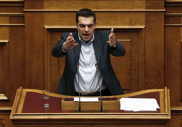 Greek PM easily wins confidence vote, EU showdown looms