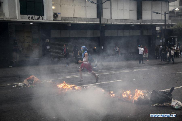 Venezuela marks anniversary of protests amid clashes