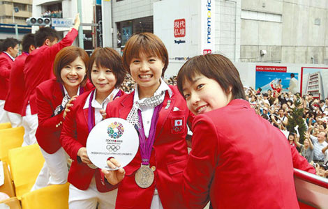 First Olympic parade brings Tokyo to standstill