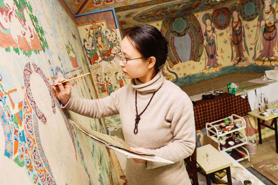 Chinese couple restore Mogao Grottoes