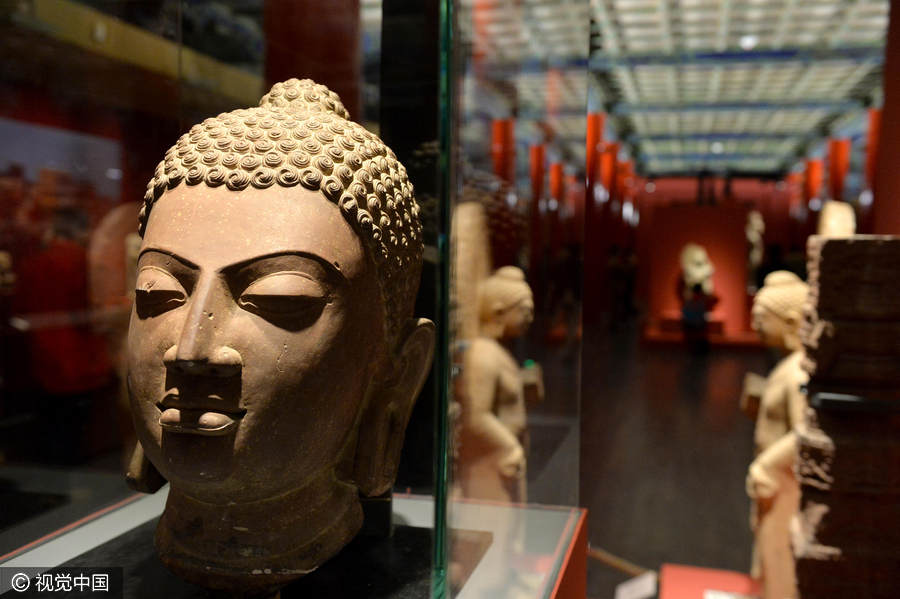 Chinese and Indian sculptures on display at the Palace Museum in Beijing