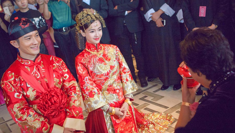 Actor Huang Xiaoming And Actress Angelababy Present Tea To Their Pas During A Traditional Chinese Wedding Ceremony Yesterday In Shanghai Photo Xinhua