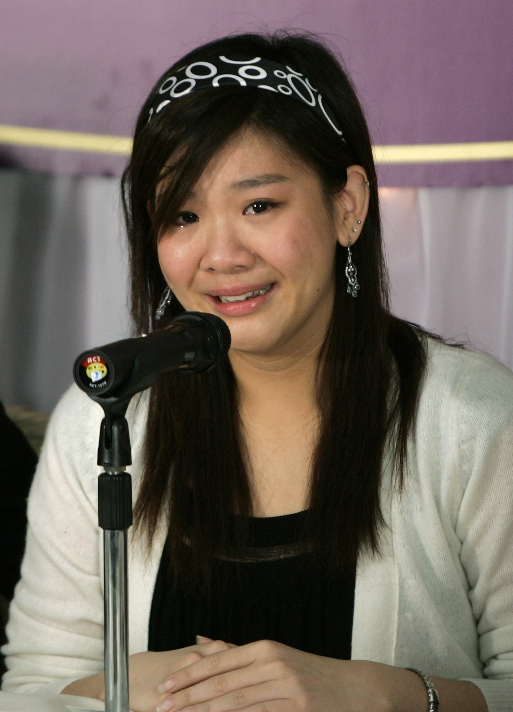 Lydia Shum's daughter cries during news conference
