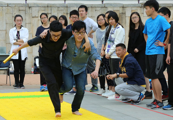 students participate in running man a competition at