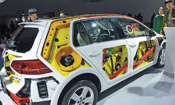 visitors examine a new energy vehicle at an auto show in zhengzhou china started offering ...