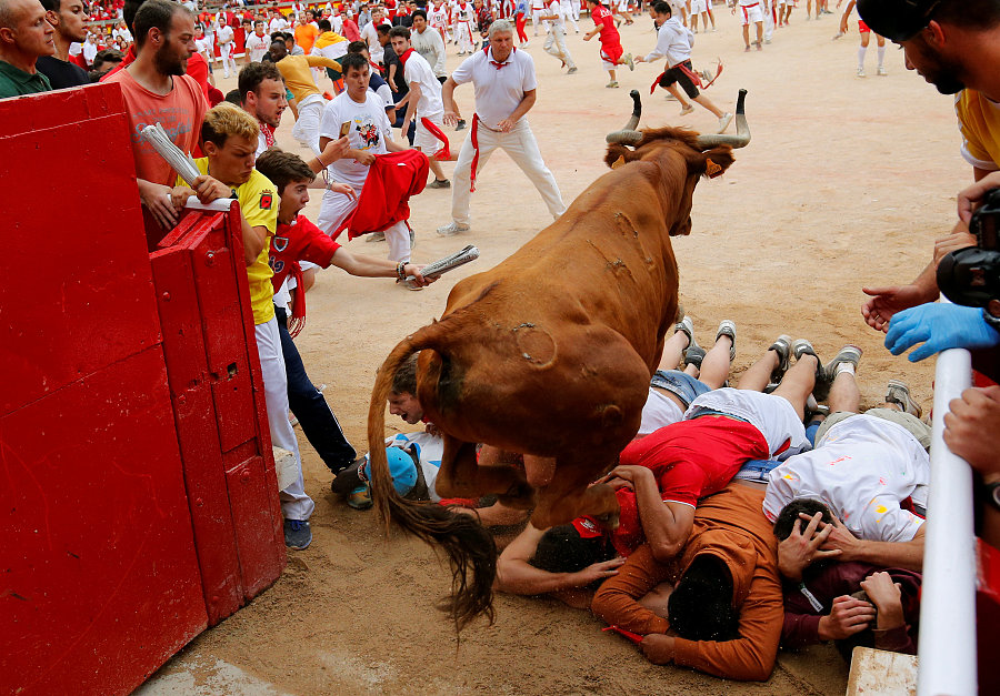 Image result for A bull leaps over revelers after this year's last running of the bulls at the San Fermin festival in Pamplona, Spain, July 14, 2017.